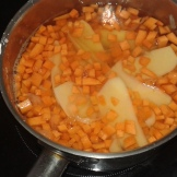 Cook potatoe inside with two carrots in cubes