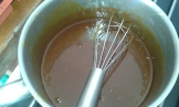 Une fois de couleur caramel foncé, ajouter la crème et après le beurre à l'aide d'un fouet. Once the sugar is browned, add cream and whip fast, then butter, whip, let cool , and put in fridge to become thick