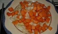 Cut carrots and oninons in mirepoix mirepoix
